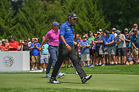 Hideki Matsuyama (JPN) and Rory McIlroy (NIR) head down 4 during 2nd round of the World Golf Championships - Bridgestone Invitational, at the Firestone Country Club, Akron, Ohio. 8/3/2018.<br /> Picture: Golffile | Ken Murray<br /> <br /> <br /> All photo usage must carry mandatory copyright credit (© Golffile | Ken Murray)