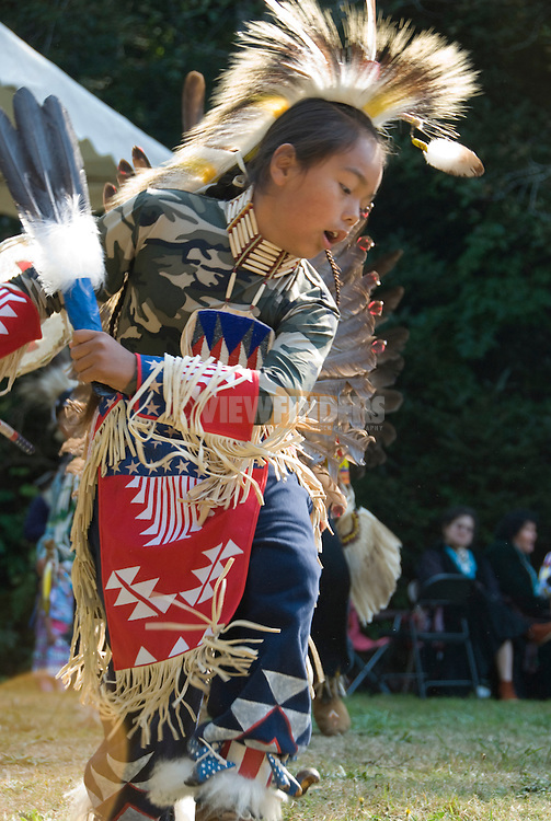 Young boy in traditional costume demonstrate a native American dance at the Depoe Bay Salmon Bake, Depoe Bay, Oregon
