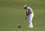 Francesco Molinari plays his 3rd shot on the 18th hole during the Final Day of the Dubai World Championship, Earth Course, Jumeirah Golf Estates, Dubai, 28th November 2010..(Picture Eoin Clarke/www.golffile.ie)