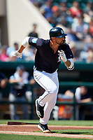 Detroit Tigers right fielder Nicholas Castellanos (9) runs to first base during a Grapefruit League Spring Training game against the Atlanta Braves on March 2, 2019 at Publix Field at Joker Marchant Stadium in Lakeland, Florida.  Tigers defeated the Braves 7-4.  (Mike Janes/Four Seam Images)