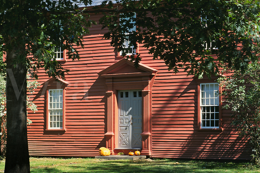 Massachusetts, Old Deerfield;  Rust Colored Facade Of Colonial Home And Door With Pumpkins On Porc