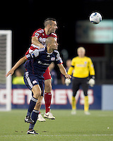 FC Dallas defender Andrew Jacobson (4) and New England Revolution forward Rajko Lekic (10) battle for head ball. In a Major League Soccer (MLS) match, the New England Revolution defeated FC Dallas, 2-0, at Gillette Stadium on September 10, 2011.