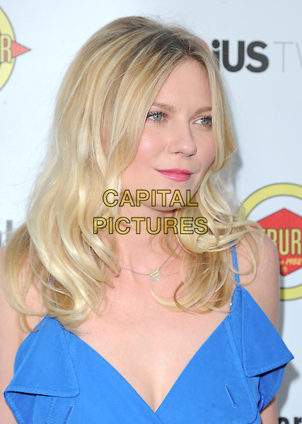 Kirsten Dunst.'Bachelorette' film premiere at The Arclight Theatre in Hollywood, California, USA..23rd August 2012.headshot portrait blue  .CAP/DVS.©DVS/Capital Pictures.