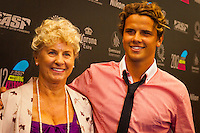 GOLD COAST, Queensland/Australia (Friday, February 24, 2012) Julian Wilson (AUS) with mother Nola.  The 29th Annual ASP World Surfing Awards went off tonight at the Gold Coast Convention and Exhibition Centre with the worlds best surfers trading the beachwear for formal attire as the 2011 ASP World Champions were officially crowned.. .Kelly Slater (USA), 40, and Carissa Moore (HAW), 19, took top honours for the evening, collecting the ASP World Title and ASP Womens World Title respectively.. .I have actually been on tour longer than some of my fellow competitors have been alive, Slater said. All joking aside, its truly humbling to be up here and honoured in front of such an incredible collection of surfers. I want to thank everyone in the room for pushing me to where I am...In addition to honouring the 2011 ASP World Champions, the ASP World Surfing Awards included new accolades voted on by the fans and the surfers themselves...For the first time in several years, ASP Life Membership was awarded to Hawaiian legend and icon of high-performance surfing, Larry Bertlemann (HAW), 56...Where surfing is today is where I dreamed it should be in the 70s, Bertlemann said. You guys absolutely deserve this and Im so honored to be up here in front of you all tonight..Grammy Award-winning artists Wolfmother and The Vernons rounded out the nights entertainment which was all streamed LIVE around the world on YouTube.com..Photo: joliphotos.com