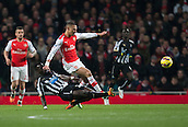 13.12.2014.  London, England. Premier League. Arsenal versus Newcastle. Newcastle United's Cheik Ismael Tioté goes in hard on Arsenal's Kieran Gibbs.