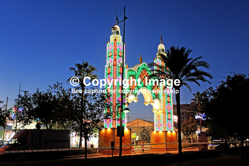Colourful, illuminated entrance to annual fiesta, fairground San Pedro de Alcantara, Marbella, Spain, 201510151742<br />
