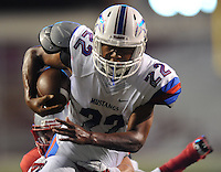 STAFF PHOTO ANDY SHUPE - Midland Christian running back Simeon Mayberry (22) carries the ball as Highland linebacker Garrett Hussong defends during the first half of play Monday, Sept. 1, 2014, at Razorback Stadium in Fayetteville.