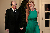Samantha Power, U.S. Ambassador to the United Nations, right, and Cass Sunstein arrive to a state dinner hosted by U.S. President Barack Obama and U.S. First Lady Michelle Obama in honor of French President Francois Hollande at the White House in Washington, D.C., U.S., on Tuesday, Feb. 11, 2014. Obama and Hollande said the U.S. and France are embarking on a new, elevated level of cooperation as they confront global security threats in Syria and Iran, deal with climate change and expand economic cooperation. <br /> Credit: Andrew Harrer / Pool via CNP