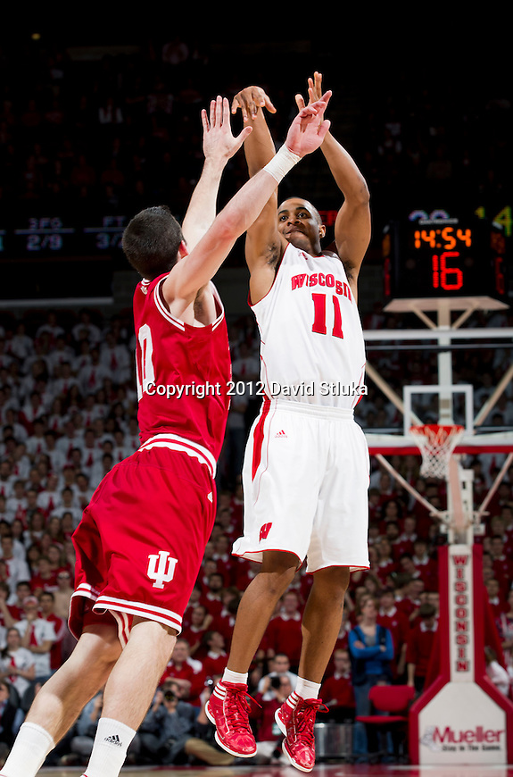 Wisconsin Badgers guard Jordan Taylor (11) shoots a 3-pointer during a Big Ten Conference NCAA college basketball game against the Indiana Hoosiers on January 26, 2012 in Madison, Wisconsin. The Badgers won 57-50. (Photo by David Stluka)