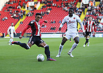 Jake Bennett of Sheffield United in action with Amadou Bakayoko of Walsall during the Carabao Cup round One match at Bramall Lane Stadium, Sheffield. Picture date 9th August 2017. Picture credit should read: Jamie Tyerman/Sportimage