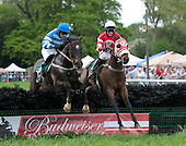 Debra Kachel's Embezzle, with Robbie Walsh in the red and white colors, fights off Sumo Power and Mark Watts at the last in the Ford Conger Maiden Claimer.