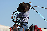 A young cowboy is realizing how hard it is to throw a rope on the ranch