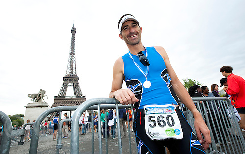 10 JUL 2011 - PARIS, FRA - Paul Amey poses for a picture after  finishing the Triathlon de Paris (PHOTO (C) NIGEL FARROW)