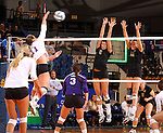 BROOKINGS, SD - NOVEMBER 9:  Courtney Roberts #6 and Wagner Larson #11 from South Dakota State University try for a block on Heather Smith #11 from Western Illinois in the first game of their match Saturday at Frost Arena. (Photo by Dave Eggen/Inertia)