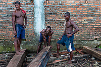 Colombian workers transport lumbers from the Pacific rainforest at a sawmill in Tumaco, Colombia, 18 June 2010. Tens of sawmills located on the banks of the Pacific jungle rivers generate almost half of the Colombia's wood production. The wood species processed here (sajo, machare, roble, guabo, cargadero y pacora) are mostly used in the construction industry and the paper production. Although the Pacific lush rainforest in Colombia is one of the most biodiverse area of the world, the region suffers an extensive deforestation due to the uncontrolled logging in the last years.