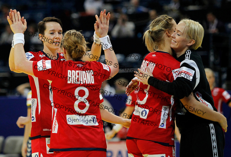BELGRADE, SERBIA - DECEMBER 08: Kristine Lunde-Borgersen and Karoline Dyhre Breivang (L) and Marit Malm Frafjord and Katrine Lunde Haraldsen of Norway celebrate victory against Ukraine during the Women's European Handball Championship 2012 Group A match between Norway and Ukraine at Arena Hall on December 08, 2012 in Belgrade, Serbia. (Photo by Srdjan Stevanovic/Getty Images)