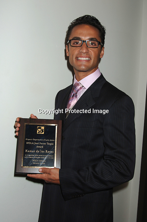 Kamar de los Reyes and his award from HOLA.. at The Hispanic Organization of Latin Actors Annual ..Awards Presentation and Benefit celebrating Latinos in ..entertainment on September 18, 2006 at ..The Schomburg Center. ..Robin Platzer, Twin Images