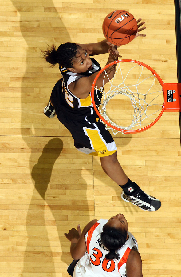 Dec. 18, 2010; Charlottesville, VA, USA; UMBC Retrievers guard Kristin Coles (22) shoots the ball in front of Virginia Cavaliers forward Telia McCall (30) during the game at the John Paul Jones Arena. Virginia won 61-46. Mandatory Credit: Andrew Shurtleff