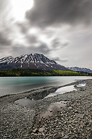 Kenai Lake near Cooper Landing experiences a typical cloudy spring day.