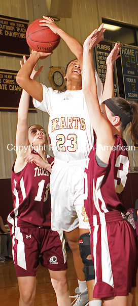 WATERBURY, CT-25 January 012514MK14 Sacred Heart's Mikyla Jacobs (23) puts up a shot up as Torrington's Brie Pergola (13) Mika Howard (22) and Olivia Morrison (30) defends during NVL girl's basketball action Saturday evening at Sacred Heart High School.  Sacred Heart defeated Torrington 50-42. Michael Kabelka / Republican-American