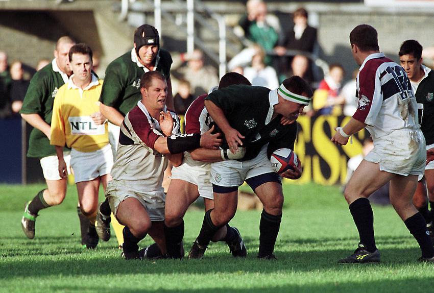Photo. Richard Lane. .London Irish v Swansea. 17/10/98. Michael Worsley takes one the Swansea defence.