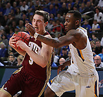 SIOUX FALLS, SD - MARCH 7:  Jake Pemberton #5 of Denver runs into South Dakota State defender Deondre Parks #0 in the 2016 Summit League Tournament.   (Photo by Dick Carlson/Inertia)