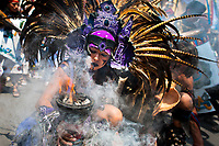 A Mexican indigenous dancer performs an ancient Aztec Death Worship dance during a religious ceremony honoring Santa Muerte (Saint Death) in Tepito, a dangerous neighborhood of Mexico City, Mexico, 1 May 2011. The religious cult of Santa Muerte is a syncretic fusion of Aztec death worship rituals and Catholic beliefs. Born in lower-class neighborhoods of Mexico City, it has always been closely associated with crime. In the past decades, original Santa Muerte's followers (such as prostitutes, pickpockets and street drug traffickers) have merged with thousands of ordinary Mexican Catholics. The Saint Death veneration, offering a spiritual way out of hardship in the modern society, has rapidly expanded. Although the Catholic Church considers the Santa Muerte's followers as devil worshippers, on the first day of every month, crowds of believers in Saint Death fill the streets of Tepito. Holding skeletal figurines of Holy Death clothed in a long robe, they pray for power healing, protection and favors and make petitions to 'La Santísima Muerte', who reputedly can make life-saving miracles.
