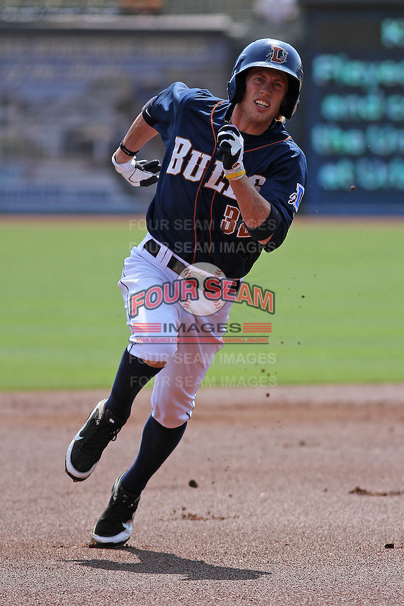 Durham Bulls outfielder Kyle Hudson #32 legging out a triple during a game against the Louisville Bats at Durham Bulls Athletic Park on May 2, 2012 in Durham, North Carolina. Durham defeated Louisville by the score of 7-5. (Robert Gurganus/Four Seam Images)