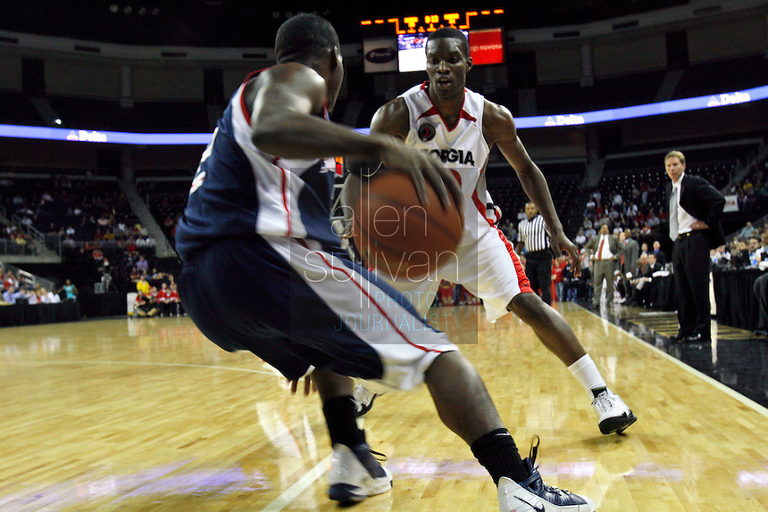 Gonzaga University guard Jeremy Pargo and University of Georgia guard-forward Terrance Woodbury in a basketball game at The Arena at Gwinnett Center in Duluth, Ga. on Saturday, Dec. 16, 2006. Georgia won 96-83.<br />