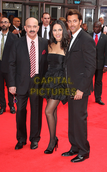RAKESH ROSHAN, BARBARA MORI & HRITHIK ROSHAN.European Premiere of 'Kites' at the Odeon West End, Leicester Square, London, England. .May 18th 2010.full length black dress suit.CAP/ROS.©Steve Ross/Capital Pictures.