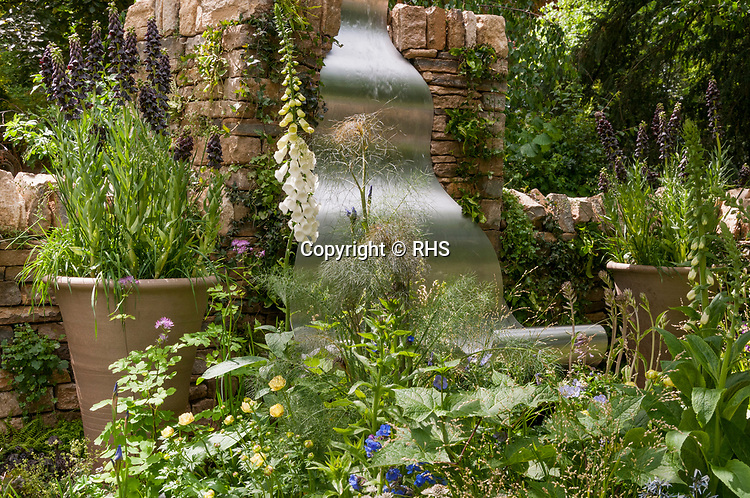 The Poetry Lover's Garden. Designed by: Fiona Cadwallader. RHS Chelsea Flower Show 2017. Stand no. Artisan Garden 565