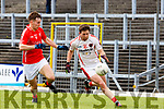 Mark Reen Rathmore takes on Dan O'Donoghue East Kerry contest the loose ball during their SFC clash in Fitzgerald Stadium on Sunday