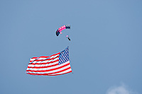 May 28, 2011.   May 28, 2011.    Cindy Irish of the Misty Blues All Women Skydiving Team flies with the American flag during the introductory National Anthem prior to the start of the St. Augustine Air Show in St. Augustine, Florida