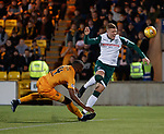 29.03.2019 Livingston v Hibs: Hakeem Odoffin tackles Florian Kamberi
