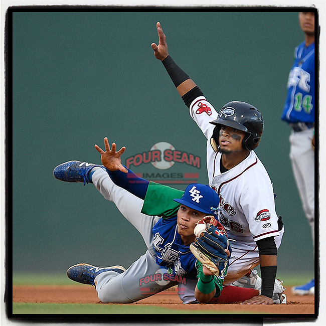 Kervin Suarez (36) of the Greenville Drive and shortstop Jeison Guzman (11) of the Lexington Legends both await the unpire's call after Suarez stole second base in a game on Sunday, September 2, 2018, at Fluor Field at the West End in Greenville, South Carolina. Greenville won, 7-4. (Tom Priddy/Four Seam Images)