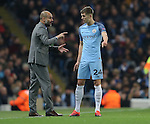 Josep Guardiola manager of Manchester City talks to John Stones of Manchester City during the Champions League Group C match at the Etihad Stadium, Manchester. Picture date: November 1st, 2016. Pic Simon Bellis/Sportimage