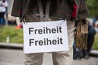 """Auf und rund um den Rosa-Luxemburg-Platz in Berlin-Mitte haben am Samstag den 25. April 2020 mehrere hundert Menschen gegen die Einschraenkungen im Zuge der Massnahmen zur Eindaeemung der Covid-19-Pandemie protestiert. Rechtsextremisten, Hooligans, Antisemiten, Verschwoerungstheoretiker und AfD-Politiker hatten zu einer sogenannten """"Hygiene-Demo"""" versammelt. Vereinzelt protestierten Menschen am Rande gegen diese Demonstration.<br /> Die Polizei war mit mehreren hundert Beamten im Einsatz und nahm mehr als 100 Personen fest.<br /> Im Bild: Ein Demonstrant hat sich ein Schild mit der Aufschrift """"Freiheit Freiheit"""" vor seinen Hintern gehaengt.<br /> 25.4.2020, Berlin<br /> Copyright: Christian-Ditsch.de<br /> [NUR FUER REDAKTIONELLE ZWECKE! Werbung nur auf Anfrage beim Fotografen. Inhaltsveraendernde Manipulation des Fotos nur nach ausdruecklicher Genehmigung des Fotografen. Vereinbarungen ueber Abtretung von Persoenlichkeitsrechten/Model Release der abgebildeten Person/Personen liegen nicht vor. NO MODEL RELEASE! Don't publish without copyright Christian-Ditsch.de, Veroeffentlichung nur mit Fotografennennung, sowie gegen Honorar, MwSt. und Beleg. Konto: I N G - D i B a, IBAN DE58500105175400192269, BIC INGDDEFFXXX, Kontakt: post@christian-ditsch.de<br /> Bei der Bearbeitung der Dateiinformationen darf die Urheberkennzeichnung in den EXIF- und  IPTC-Daten nicht entfernt werden, diese sind in digitalen Medien nach §95c UrhG rechtlich geschuetzt. Der Urhebervermerk wird gemaess §13 UrhG verlangt.]"""
