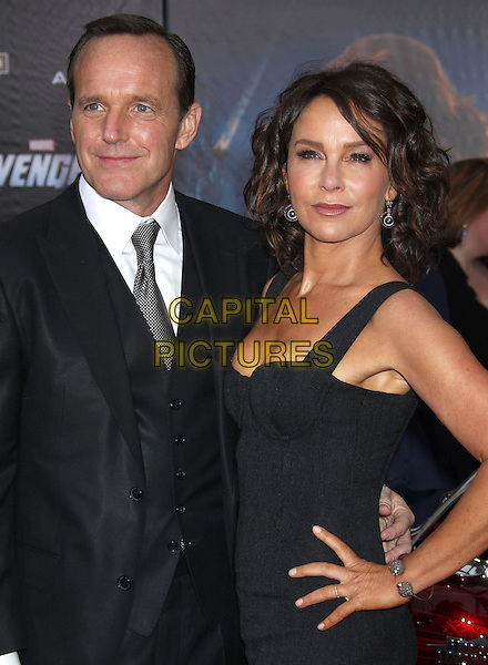 "Clark Gregg, Jennifer Grey.""Marvel's The Avengers"" World Premiere held at the El Capitan Theatre, Hollywood, California, USA..April 11th, 2012.half length dress suit waistcoat married husband wife  black hand on hip.CAP/ADM/RE.©Russ Elliot/AdMedia/Capital Pictures."