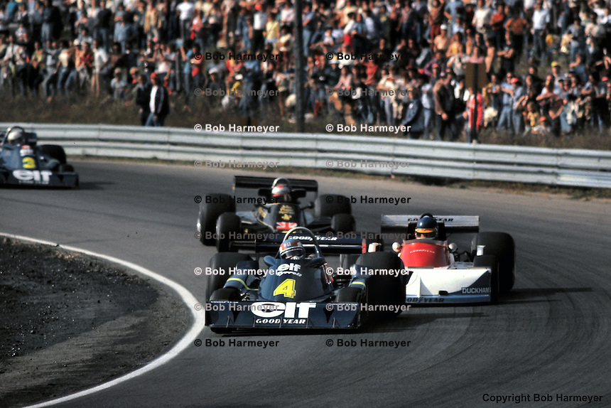 Patrick Depailler, driving a Tyrrell P34 six-wheel Formula 1 car, leads a group during the 1976 Canadian Grand Prix at Mosport, Canada.