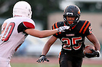 SIOUX FALLS, SD - AUGUST  28: Michael Enalls #25 from Washington looks to make a move against Chase Grode #20 from Brandon Valley in the first half of their game Friday night at Howard Wood Field. (Photo by Dave Eggen/Inertia)
