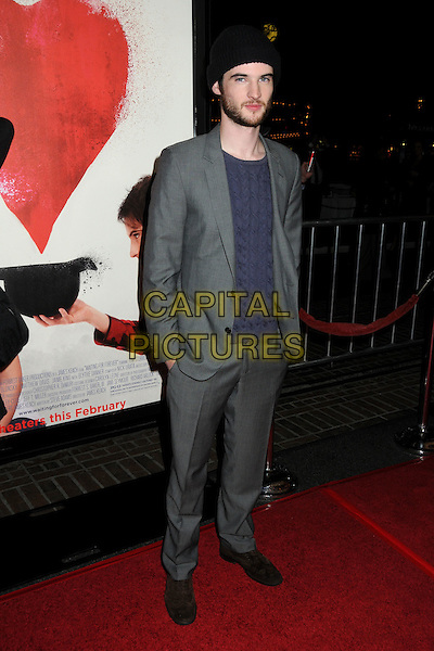 "TOM STURRIDGE .""Waiting For Forever"" Los Angeles Premiere held at Pacific Theatres at The Grove, Los Angeles, California, USA, .1st February 2011..full length grey gray suit hand in pockets  blue t-shirt .CAP/ADM/BP.©Byron Purvis/AdMedia/Capital Pictures."