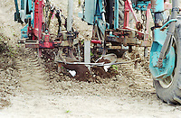 Sand. Special plough clearing soil around the vines. Chateau Giscours, Margaux, Medoc, Bordeaux, France