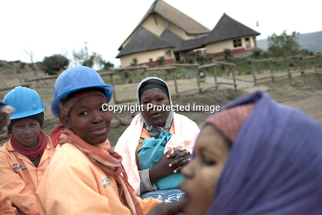 MVEZO, SOUTH AFRICA - MARCH 28: Workers at a construction of a museum and conference center being built by Mandla Mandela on March 28, 2012 in Mvezo South Africa. Nelson Mandela was born in this rural village in 1918 and moved to nearby Qunu as a young boy. Qunu is about 32 kilometers away. (Photo by Per-Anders Pettersson)