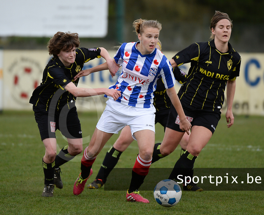 20140315 - WESTERLO , BELGIUM : Heerenveen Vivianne Miedema pictured with Lierse Evelien Stoffels (r) and Lierse Tinne Van Den Bergh (l) during the soccer match between the women teams of SK Lierse Dames  and SC Heerenveen Vrouwen , on the 19th matchday of the BeNeleague competition Saturday 15 March 2014 in Westerlo . PHOTO DAVID CATRY
