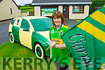Kitty Flynn Upper Tullig Killorglin cheering on the Kerry team with a Kerry coloured car in her front Garden.