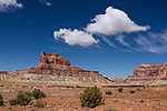 Cumulus and high, streaking cirrus clouds over Assembly Hall Peak in the Mexican Mountain Wilderness Study Area on the San Rafael Swell in Utah.