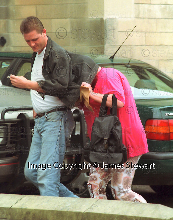 Notorious &lsquo; family from hell &rsquo; matriarch Big Mags Haney who has died of lung cancer&hellip; The picture shows that she was sometimes shy of the camera trying to hide, and looking like the rear end of a pantomime horse, as she arrives at Stirling Sheriff Court to face charges of assaulting a neighbour in 1995.    <br /> <br /> Picture taken August 1995  <br /> jsp007_haney   <br /> Copyright  Pic : James Stewart    <br /> James Stewart Photography, 19 Carronlea Drive, Falkirk. FK2 8DN      <br /> Vat Reg No. 607 6932 25     <br /> Mobile : +44 (0)7721 416997    <br /> E-mail  :  jim@jspa.co.uk    <br /> If you require further information then contact Jim Stewart on any of the numbers above .....