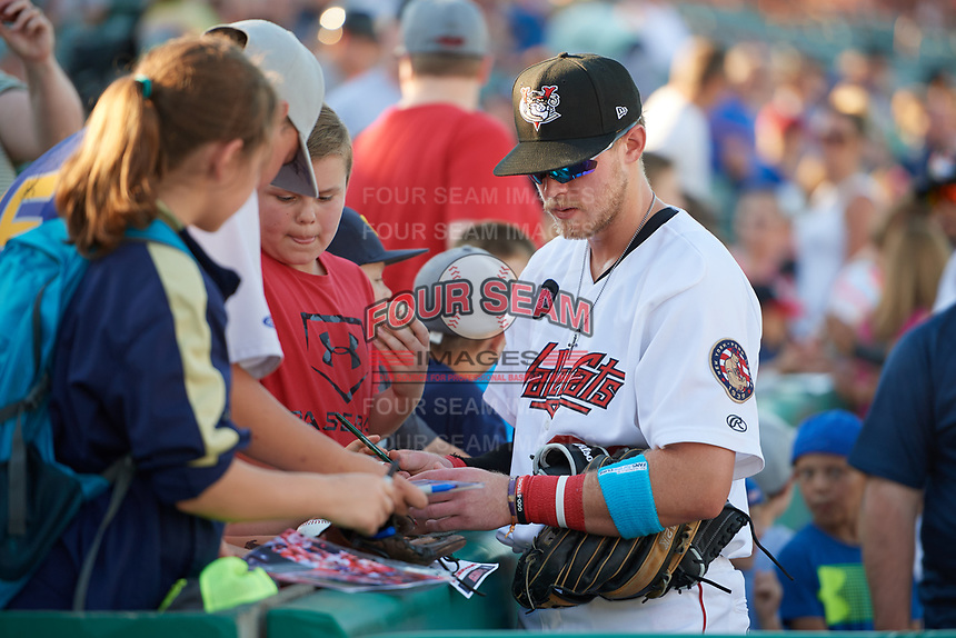 Tri-City ValleyCats Seth Beer (34) signing autographs for fans before a game against the Vermont Lake Monsters on June 16, 2018 at Joseph L. Bruno Stadium in Troy, New York.  Vermont defeated Tri-City 6-2.  (Mike Janes/Four Seam Images)