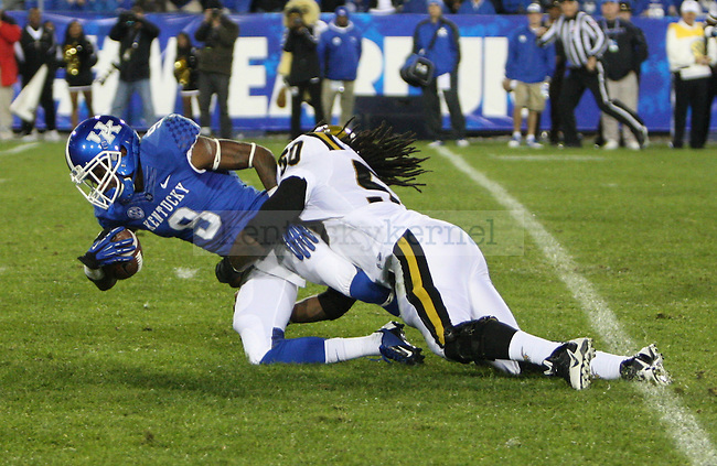 UK running back Jojo Kemp (3) gets tackled by Alabama State linebacker Leland Baker (50) during the University of Kentucky Homecoming football game against Alabama State at Commonwealth Stadium in Lexington, Ky., on Saturday, November 2, 2013. Photo by Tessa Lighty | Staff