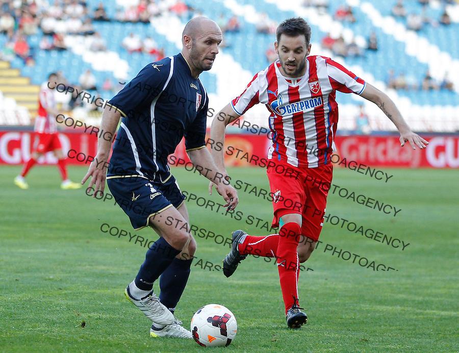 Fudbal Jelen super league season 2013-2014<br /> Crvena Zvezda v Radnicki Nis<br /> Sasa Stojanovic (L) and Milos Ninkovic<br /> Beograd, 04.22.2014.<br /> foto: Srdjan Stevanovic/Starsportphoto&copy;